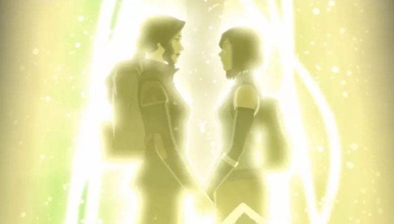 Korra and Asami holding hands as they enter the spirit portal