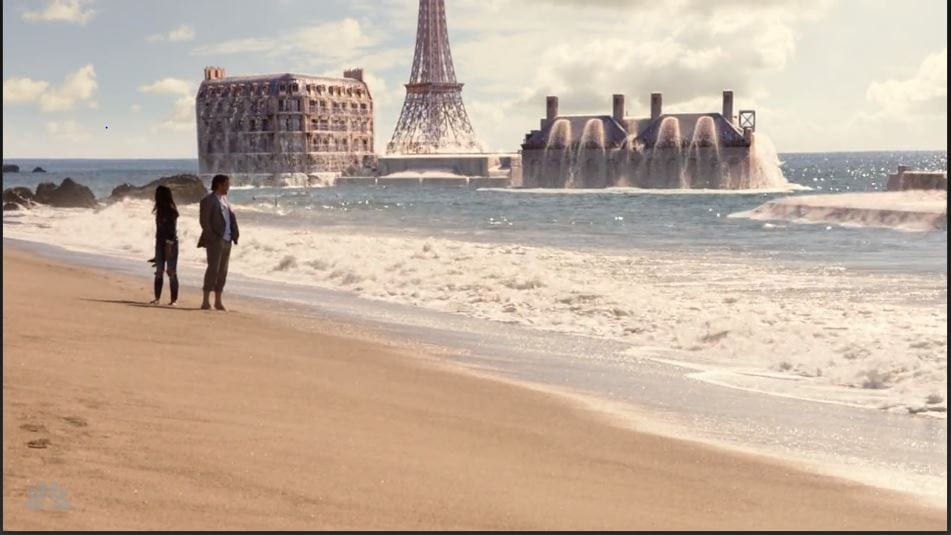 An image of Paris rising up from a beach
