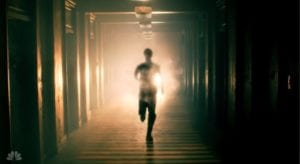 A man running, while on fire