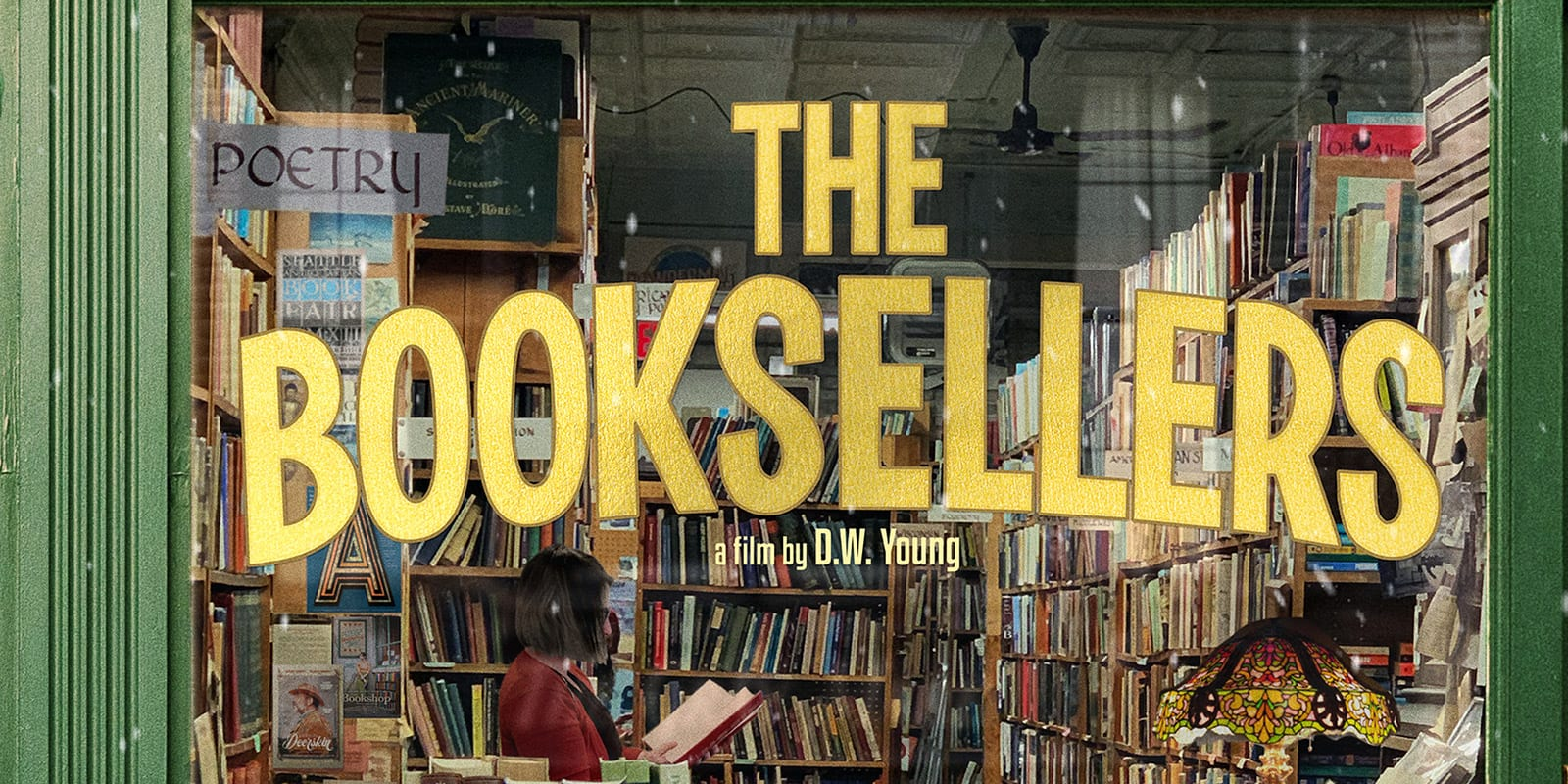 the booksellers in yellow font on a green window