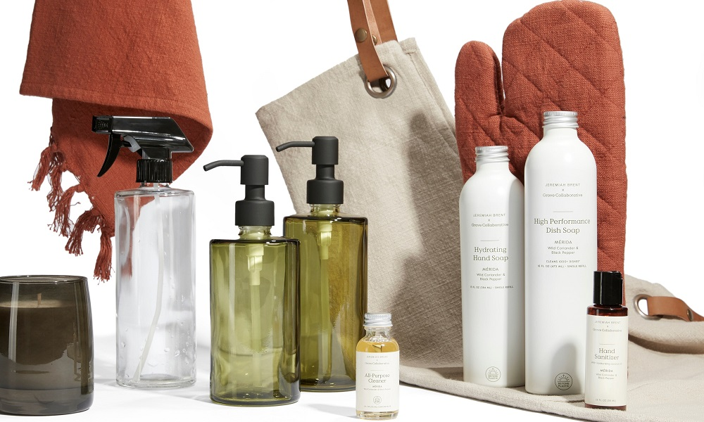 jeremiah brent collection candle, oven mitt, apron, and towel, green glass bottle soap dispensers, and other cleaning products