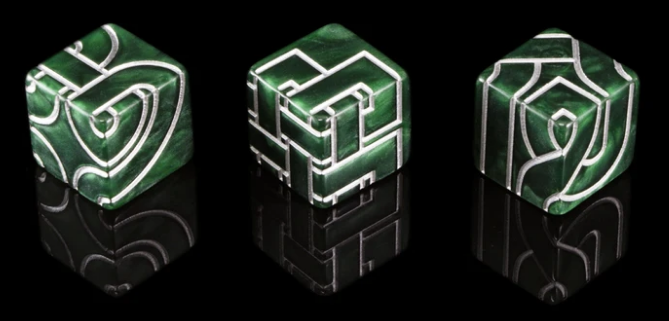 three green dice with silver celtic designs