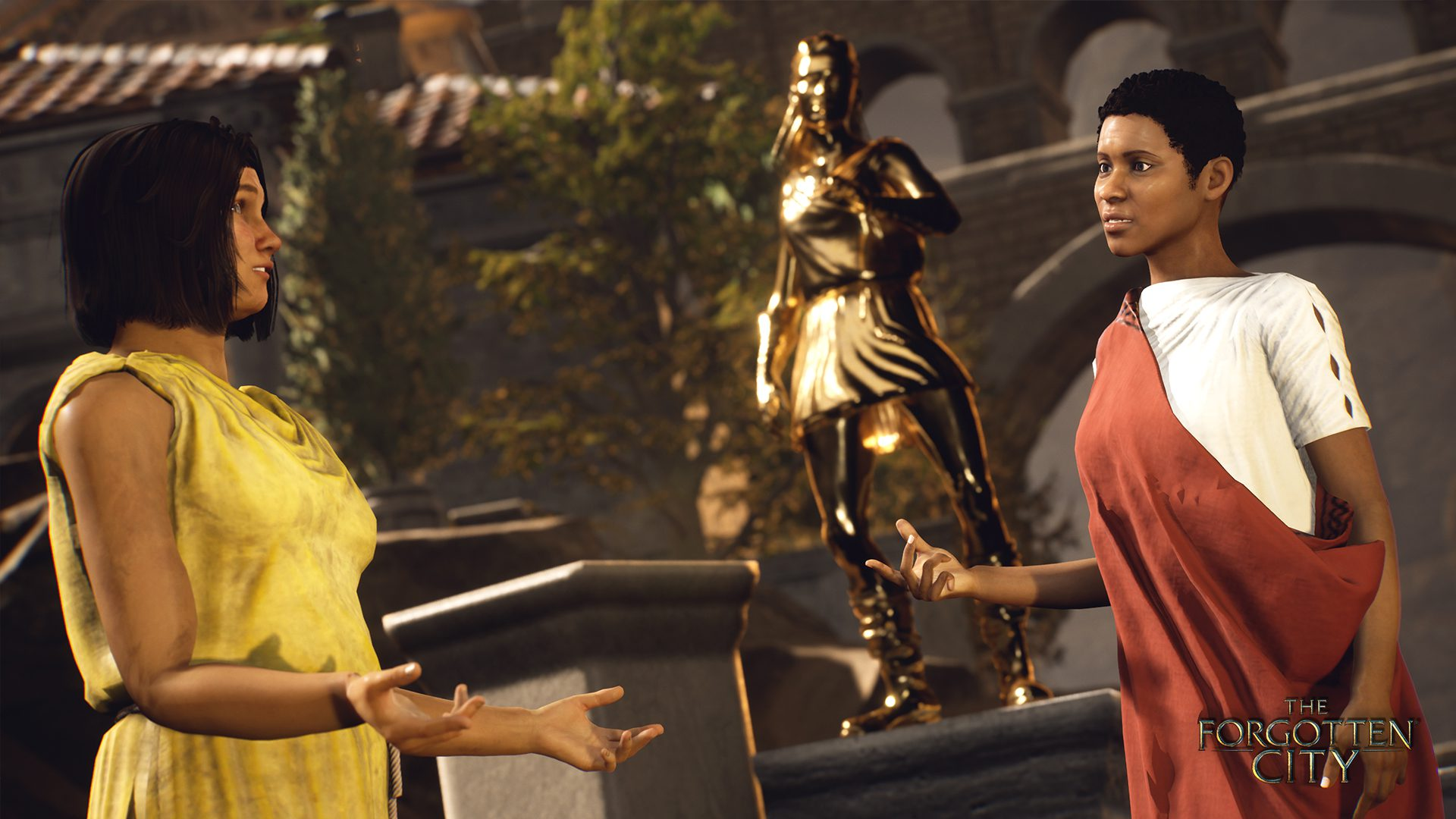 Two characters in Roman dress stand talking in front of a golden statue of a woman who looks to be in pain.