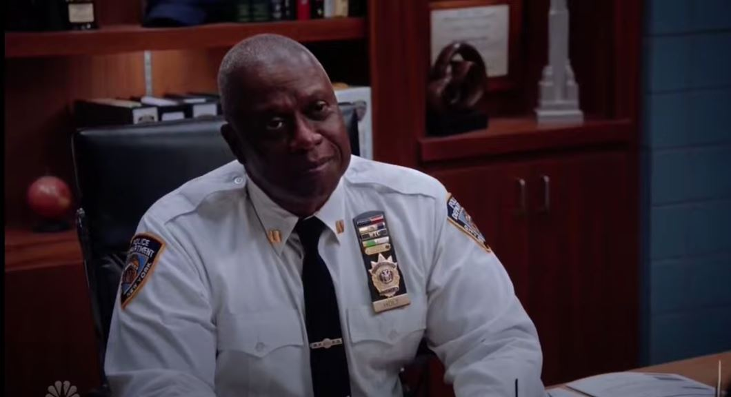 Captain Holt smiling from the Brooklyn Nine-Nine premiere