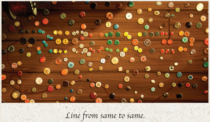 """colorful buttons scattered on a table above the text """"line from same to same"""""""